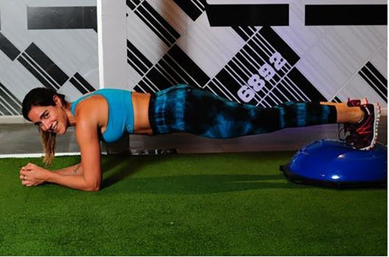 A half ball can be used in planks to push the body to work harder.